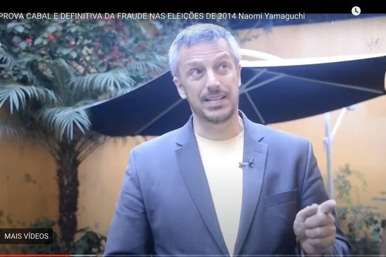 Reprodução de vídeo do YouTube sobre suposta fraude eleitoral em 2014, com astrólogo Alexandre Chut.